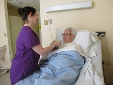 Care worker supporting a resident