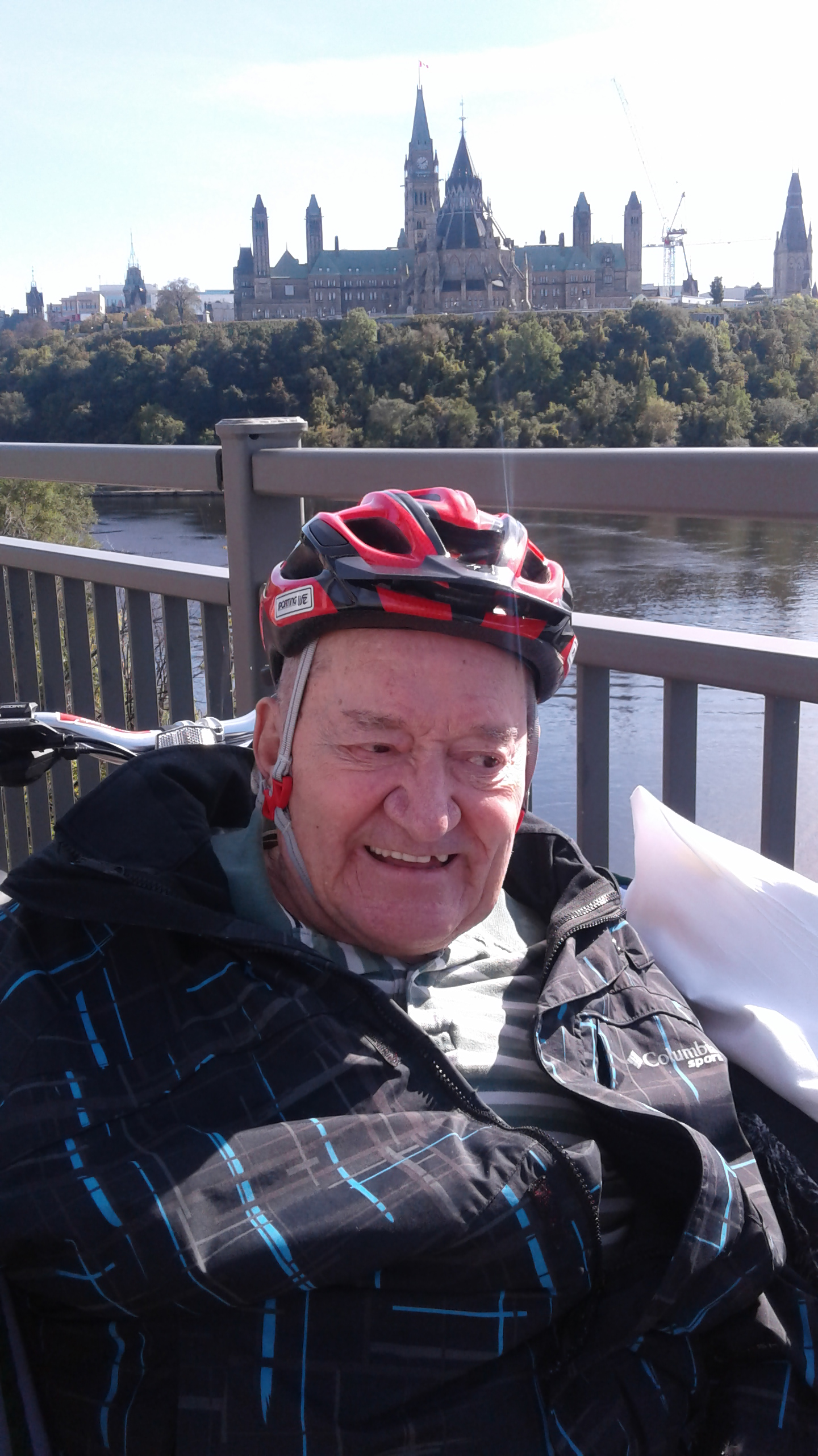 Senior in Cycling Without Age bike overlooking Parliament.