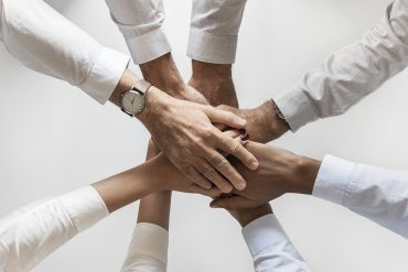 Circle of hands to represent teamwork
