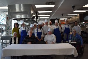Group photo of the cooking competition judges and participants
